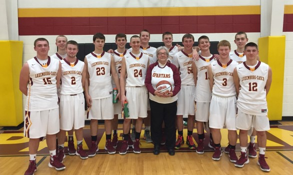 Luxemburg-Casco Boys Basketball Fan of the Year Myra Tlachac poses with the Spartans following the 111-73 win over Southern Door Monday night. Left to Right: Mason Isenberg, Mitch Jandrin, Malaki Wessel, Nathan Coisman, Mitch Ronsman, Bryce TeKulve, Spencer Kanz, Myra Tlachac, Jake Zeitler, Keegan Sewell, Chance Junio, Jon Deprey, Jacob Wotruba, Anthony Otradovec.